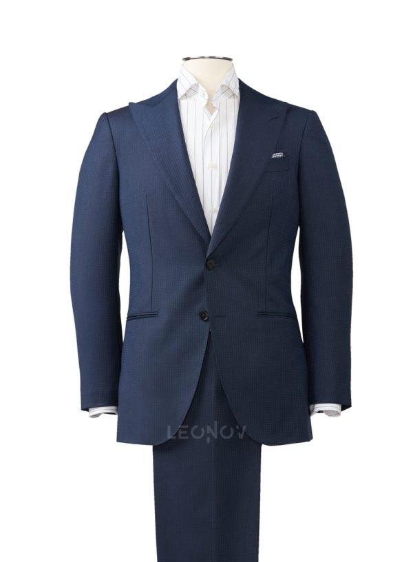 Клетчатый темно-синий костюм