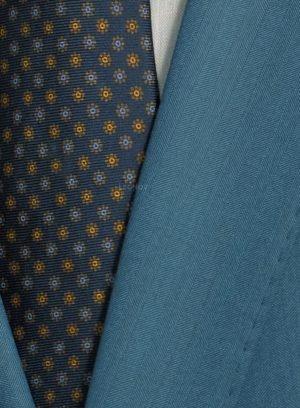 Бирюзовый костюм из шерсти и шелка